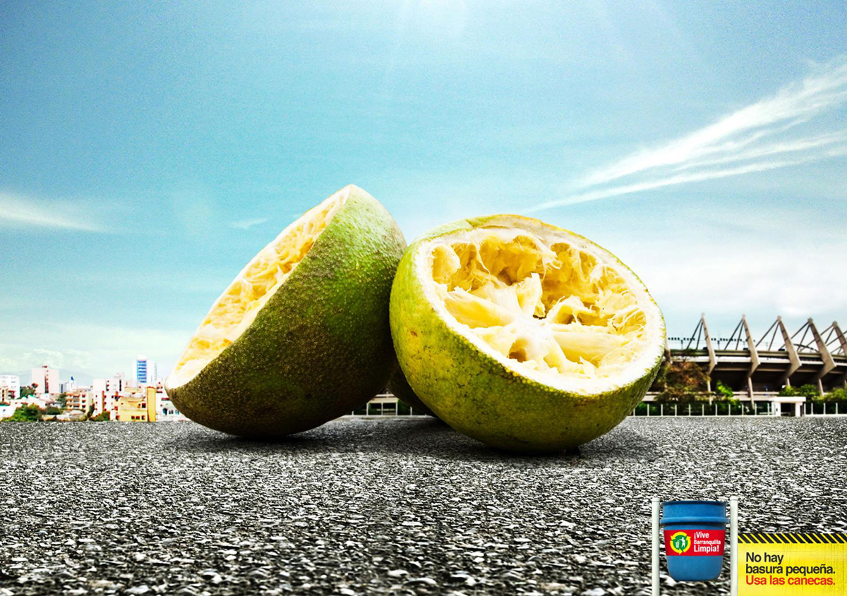 A photo with a giant lime in the forefront and a small city in the background.