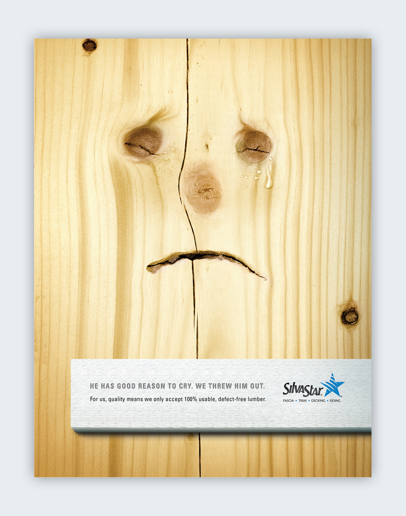 A piece of wood with a sad face on it.