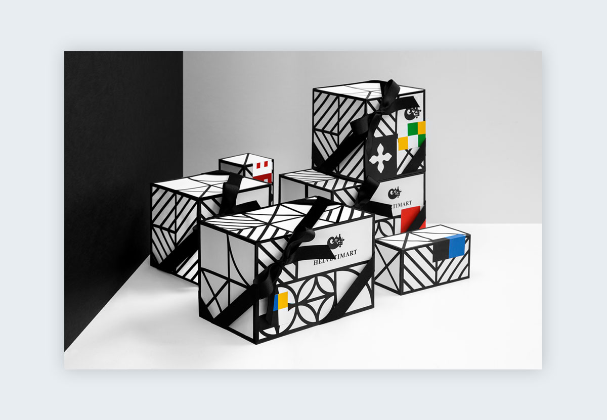 Boxes covered in black and white lines and geometric shapes.
