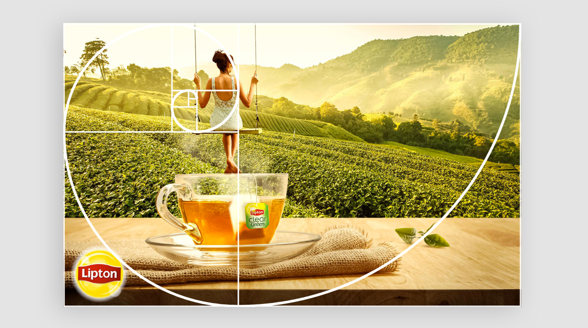 The golden ratio or mean overtop a Lipton Tea ad, showcasing the focal point.
